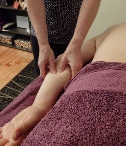 Remedial massage to an arm